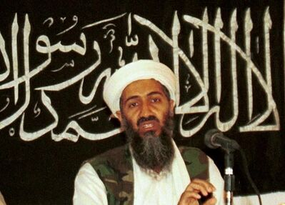 FILE - In this 1998 file photo made available on March 19, 2004, Osama bin Laden is seen at a news conference in Khost, Afghanistan. The CIA's release of documents seized during the 2011 raid that killed al-Qaida leader Osama bin Laden has again raised questions about Iran's support of the extremist network leading up to the Sept. 11 terror attacks. U.S. intelligence officials and prosecutors have long said Iran formed loose ties to the terror organization from 1991 on, something noted in a 19-page report in Arabic included in the release of some 47,000 other documents by the CIA. Iran always has denied any links. (AP Photo/Mazhar Ali Khan, File)