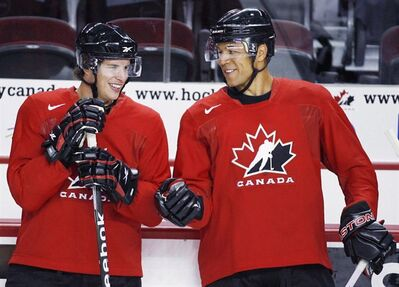 Sidney Crosby, left, and Jarome Iginla, chat during a practice at the Men's National Olympic Hockey Team orientation camp in Calgary, Tuesday, Aug. 25, 2009. The Calgary Flames Hockey Club have traded team captain Jarome Iginla in exchange for forwards Kenneth Agostino and Ben Hanowski and the Pittsburgh Penguins 2013 first round pick. THE CANADIAN PRESS/Jeff McIntosh
