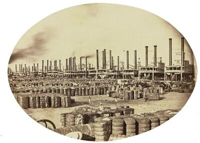 This photograph provided by the New Orleans Museum of Art, is a coated salt print of New Orleans cotton wharves sometime between 1858 and 1861 by Jay Dearborn Edwards. It is among 19th century landscape photographs in an exhibit to be shown at the museum from Oct. 6-Jan. 7, including some of the earliest photographs taken in this country. (New Orleans Museum of Art via AP)