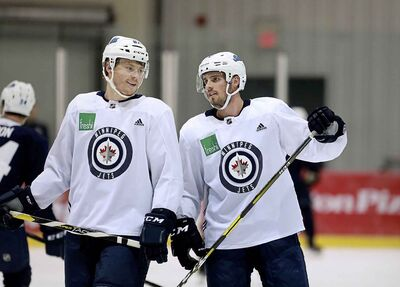Winnipeg Jets Mason Appleton, left, was added to the line with Roslovic and Vesalainen in place of veteran Mathieu Perreault for Thursday's pre-season game against the Oilers.