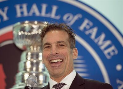 Hockey Hall of Fame inductee Chris Chelios smiles after being presented with his ring at the Hall in Toronto on Friday November 8, 2013. THE CANADIAN PRESS/Frank Gunn