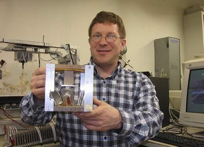 Inventor David Prystupa holds a model of his recently patented bacteria-detector device.