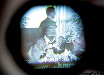 Moammar Gadhafi is seen through a television camera viewfinder as he speaks in Tripoli, Libya.