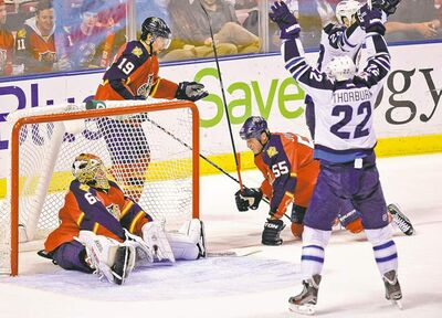 Chris Thorburn and Blake Wheeler celebrate a Jets goal in front of deflated Panthers goaltender Jose Theodore.