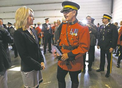 Tory MP Candice Hoeppner chats with Assistant Commissioner D.W. (Bill) Robinson of the RCMP 'D' Division at the grand opening of the new border intelligence facility in Altona Friday.