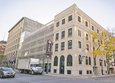 Melissa Tait / Winnipeg Free Press The Bedford Parkade at King Street and Bannatyne Avenue. Parking garages charge higher rates than surface lots.