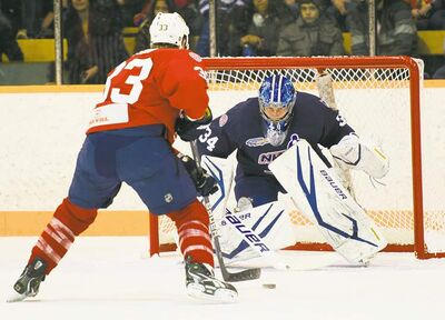 Nashville Predator Colin Wilson goes up against Toronto Maple Leafs goalie James Reimer on Saturday at the Max Bell Arena.