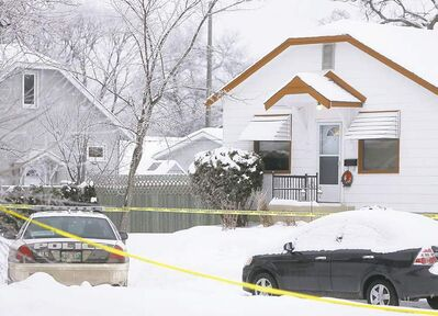 Police tape surrounds a house in the 500 block of St. Catherine Street as police investigate the death of a 49-year-old man at the home.