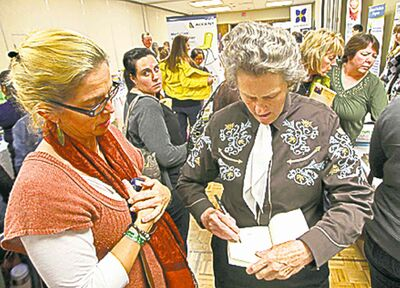Temple Grandin signs a book  for Marjorie Birch Tuesday.