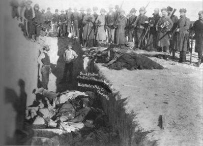 U.S. soldiers put Indians in a common grave after the massacre at Wounded Knee in 1890.