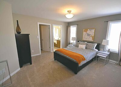 Set off by itself, the master suite, above, is big and beautifully appointed.
