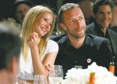 """This Jan. 11, 2014 file photo shows actress Gwyneth Paltrow, left, and her husband, singer Chris Martin at the 3rd Annual Sean Penn & Friends Help Haiti Home Gala in Beverly Hills, Calif. Paltrow and Martin are separating after 11 years of marriage. A message posed on the 41-year-old actress' blog Tuesday, March 25, says that the couple has """"come to the conclusion that while we love each other very much we will remain separate."""" Paltrow and the 37-year-old musician married in 2003. The couple has two children, nine-year-old daughter Apple and 7-year-old son Moses."""