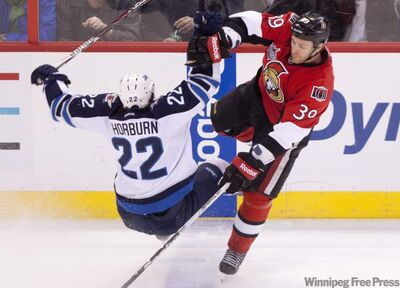 The Ottawa Senators' Matt Carkner collides with the Winnipeg Jets' Chris Thorburn during second period NHL action in Ottawa, on Monday.
