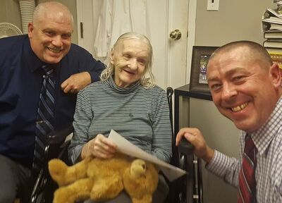 FILE - This October 2017 file photo provided by the Sullivan County Sheriff's Office shows Flora Harris, center, with Sullivan County Sheriff's Detective Sgt. Ed Clouse, left, and Detective Rich Morgan at an assisted living residence in Lowell, Mass. Harris, who disappeared from upstate New York in 1975, has been found suffering from dementia and living in the assisted-living facility in Massachusetts, authorities said. Officials said they've been unable to figure out details of what happened to her between the time she disappeared and when she was finally found. (Sullivan County Sheriff's Office via AP, File)