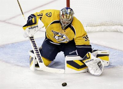Nashville Predators goalie Pekka Rinne, of Finland, blocks a shot against the New York Islanders in the second period of a preseason NHL hockey game on Sunday, Sept. 22, 2013, in Nashville, Tenn. The Predators won 2-0. (AP Photo/Mark Humphrey)