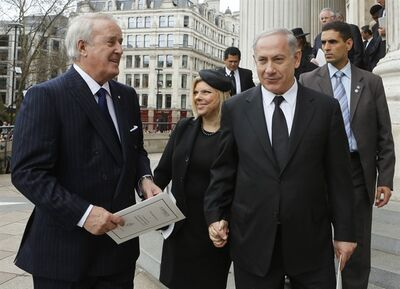 Former Canadian Prime Minister Brian Mulroney, left, Israeli Prime Minister Binyamin Netanyahu, front right, and his wife Sara, center, share a chat after attending the funeral service of former British prime minister Margaret Thatcher at St. Paul's Cathedral, London, Wednesday, April 17, 2013. (AP Photo/Olivia Harris, Pool)