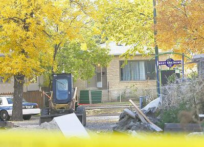 Police tape surrounds a home in the 600 block of Maryland Street  after the double  shooting early Saturday.