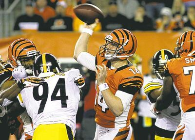 Tom Uhlman / the associated press archivesQuarterback Andy Dalton has led the Bengals to wins in five of their last six games.