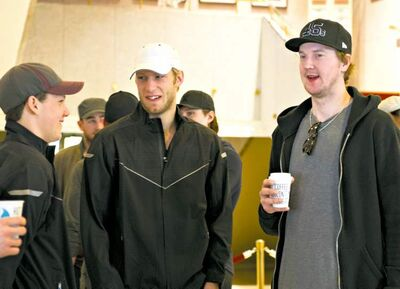From left, Team Canada's Jeff Skinner, Jordan Staal and Devan Dubnyk wait to go go-karting Monday. p