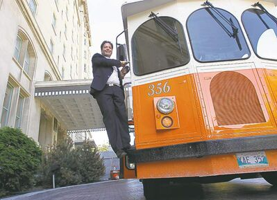Stefano Grande, executive director of the Downtown BIZ, poses beside a Winnipeg Trolley Company vehicle to announce new tours.