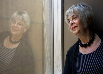 Adina Lebo, 62, looks out the window at her company's board room office in Toronto on Wednesday, May 23, 2012. At 62, Adina Lebo has experienced the unexpected fallout that too many birthdays can confer: after 21 years of providing marketing and promotional services for a major client in the Toronto arts and entertainment industry, she was shown the door. Finding new work has been a challenge, to say the least. THE CANADIAN PRESS/Nathan Denette