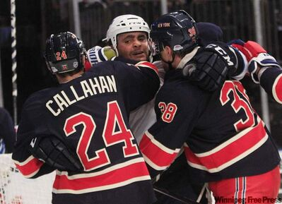 Winnipeg defenceman Dustin Byfuglien, mixes it up with New York's Ryan Callahan and Michael Sauer during first-period action in the Big Apple Sunday.