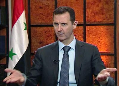 In this image from video broadcast on Syrian state television Wednesday, April 17, 2013, President Bashar Assad speaks during an interview.