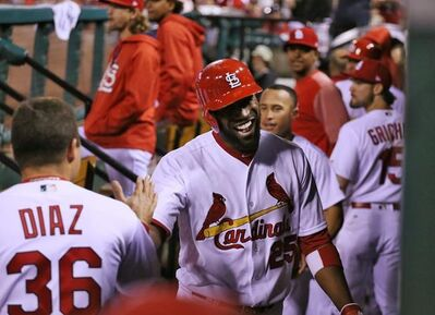 St. Louis Cardinals' Dexter Fowler is congratulated by teammates in the dugout after hitting a three-run home run in the seventh inning against the San Francisco Giants in a baseball game Friday, May 19, 2017, at Busch Stadium in St. Louis. (Chris Lee/St. Louis Post-Dispatch via AP)