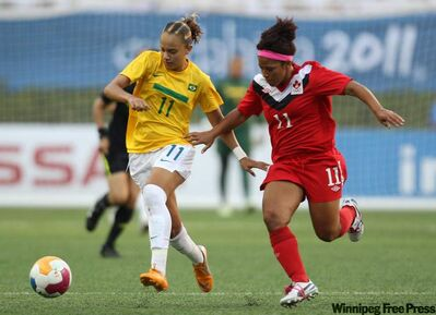 Brazil's Thais Guedes, left, is challenged by Canada's Desiree Scott during a women's soccer gold medal match at the Pan American Games in Guadalajara, Mexico, in October. Scott will head to Vancouver to take part in an Olympic soccer qualifying event.