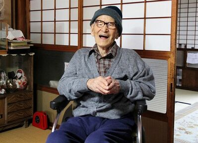 In this photo taken Oct. 15, 2012 and released by Kyotango City, Jiroemon Kimura smiles after he was presented with the certificate of the world's oldest living man from Guinness World Records Editor-in-Chief Craig Glenday at his home in the city, Kyoto Prefecture, Japan. Kyotango mayor hailed Kimura for becoming the world's oldest person Tuesday, Dec. 18, 2012. At 115 years old, Kimura inherited the title from an American woman who died Monday. (AP Photo/Kyotango City) EDITORIAL USE ONLY