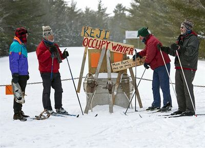 Colin Mudle, Ron Eaton, Rod Keirstead and Peter Rogers, left to right, meet at the barricaded entrance to Kejimkujik National park in Maitland Bridge, N.S. on Thursday, Jan. 24, 2013. Several of Canada's national parks, have been forced to curtail public access and services during the winter because of budget cuts. At Kejimkujik the popular back-country winter camping project with semi-permanent huts called yurts appears to have abandoned. THE CANADIAN PRESS/Andrew Vaughan