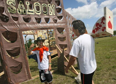 Mario De Negri (right) and Castle Boys crew member Chris Beiko get to work in 2008 at the Folk Festival campground.