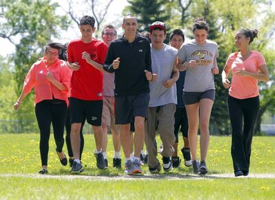 MLA Kevin Chief in St. John's Park training with some youth with whom he will be running the Manitoba Marathon.