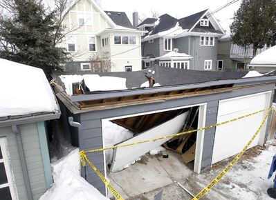 A garage in River Heights collapsed into itself this week, a result of high snow levels on the roof and an aging construction.