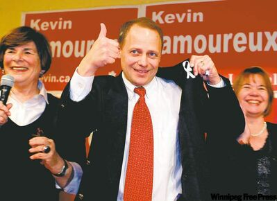 Kevin Lamoureux celebrates his Winnipeg North victory Monday with Liberal MP Anita Neville (left) and wife Cathy.