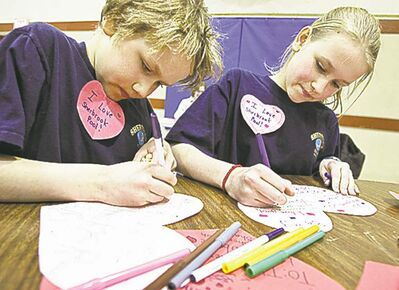 Mike Deal / Winnipeg Free PressAiden Dueck Thiessen, 9, and his sister, Jubilee, 12, work on their valentines.