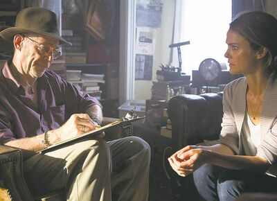 J.K. Simmons and Keri Russell in a scene from Dark Skies.