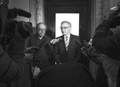 Finance Minister Stan Struthers meets with reporters on March 21.