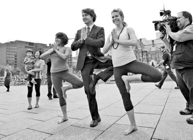 Justin Trudeau joins a yoga class on Parliament Hill last week. Now he is trying to wriggle out of a speaking-fee controversy.