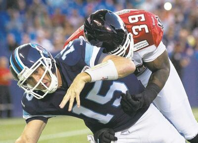 THE Canadian press archivesArgonauts quarterback Ricky Ray is injured on a tackle by Stampeders defensive lineman Charleston Hughes.