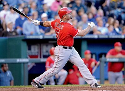 The Los Angeles Angels' Albert Pujols watches his fourth-inning solo home run against the Kansas City Royals on Thursday, May 23, 2013, at Kauffman Stadium in Kansas City, Missouri.