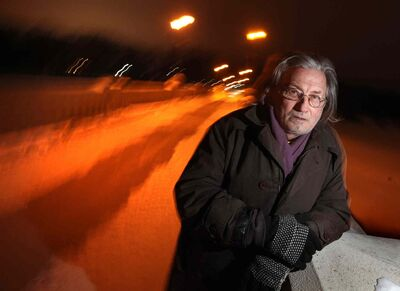 Alden Wiebe stands on the Assiniboine Park pedestrian bridge, which he jumped off of in a desperate attempt to escape his problems while homelessness in 2012.