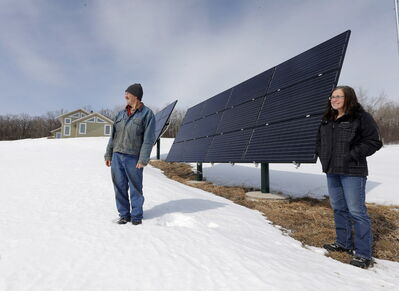 Will and Bev Eert's new home south of Portage la Prairie is powered by two large solar panels, giving them an efficient alternative to hydroelectricity.