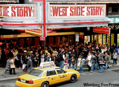 Taxis and theatres, two staples of the big city.