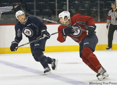Troy Bodie, right, with Derek Meech, wants fans to know he's more than just an enforcer.