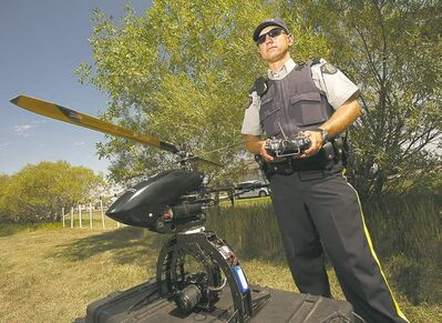 COLE BREILAND / WINNIPEG FREE PRESSCpl. Byron Charbonneau demonstrates one of the unmanned choppers the RCMP will be using to take aerial photos.