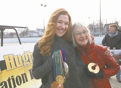 Clara Hughes with mother, Maureen Hughes, after the ceremony Saturday.