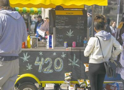 DAVID LIPNOWSKI / WINNIPEG FREE PRESS   Thousands of people attended 4/20 to celebrate cannabis at the legislative building Saturday. Those in attendance cited a recent movement among U.S. states to decriminalize marijuana in Washington and Colorado as progress.