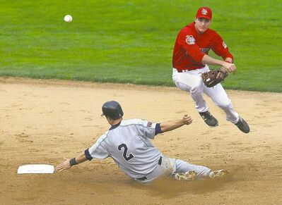 Goldeyes second baseman Nate Sampson throws to first to complete a double play in the third inning on Friday night at Shaw Park.