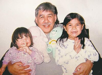 Reginald Blackbird with granddaughters Kiya (left), and Ida.
